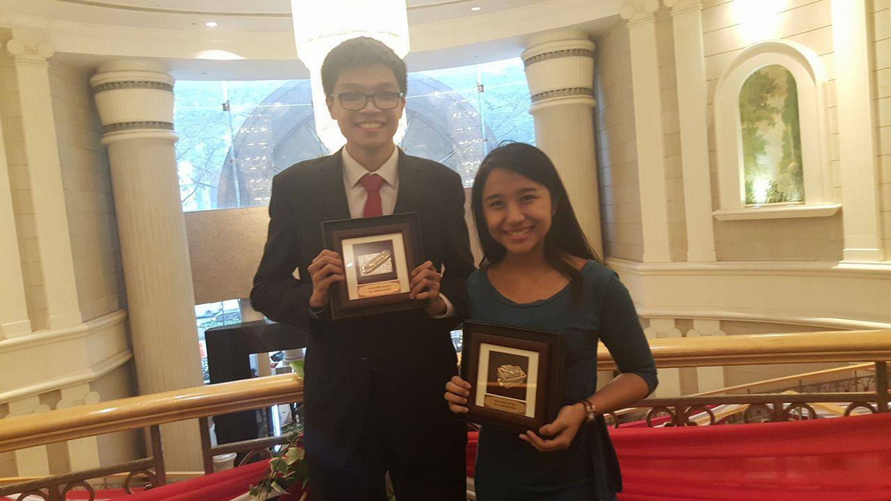 Fulfilling moment with the Asian British Parliamentary Awards (plaques).